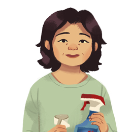 A black-haired woman with light skin in a green sweatshirt holding cleaning supplies